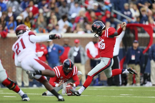 Nov 9, 2013; Oxford, MS, USA; Mississippi Rebels kicker Andrew Ritter (96) kicks a field goal during the game against the Arkansas Razorbacks at Vaught-Hemingway Stadium. Mandatory Credit: Spruce Derden-USA TODAY Sports