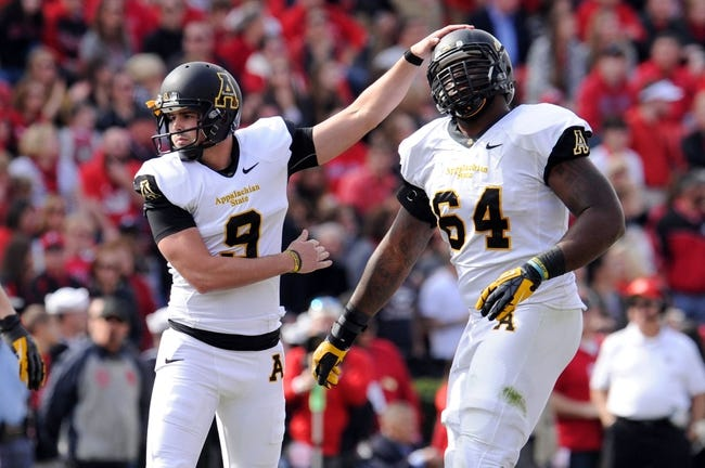 Nov 9, 2013; Athens, GA, USA; Appalachian State Mountaineers kicker Drew Stewart (9) reacts with offensive linesman Will Corbin (64) after kicking a field goal against the Georgia Bulldogs during the second quarter at Sanford Stadium. Mandatory Credit: Dale Zanine-USA TODAY Sports
