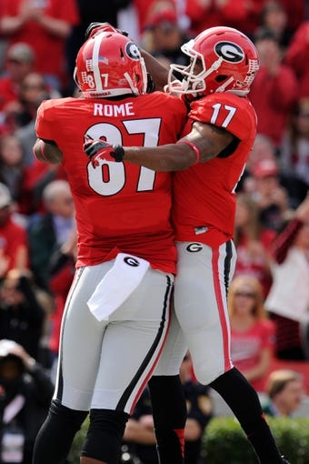 Nov 9, 2013; Athens, GA, USA; Georgia Bulldogs wide receiver Rantavious Wooten (17) celebrates with teammate tight end Jay Rome (87) after catching a touchdown pass against the Appalachian State Mountaineers during the first quarter at Sanford Stadium. Mandatory Credit: Dale Zanine-USA TODAY Sports