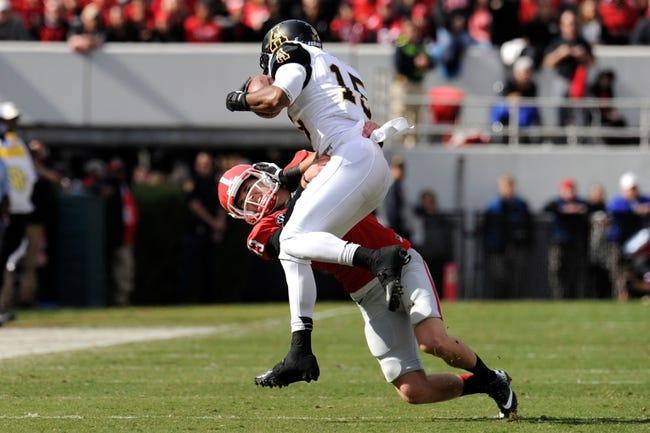 Nov 9, 2013; Athens, GA, USA; Georgia Bulldogs kicker Marshall Morgan (13) tackles Appalachian State Mountaineers wide receiver Tony Washington (15) after a kickoff during the second quarter at Sanford Stadium. Mandatory Credit: Dale Zanine-USA TODAY Sports