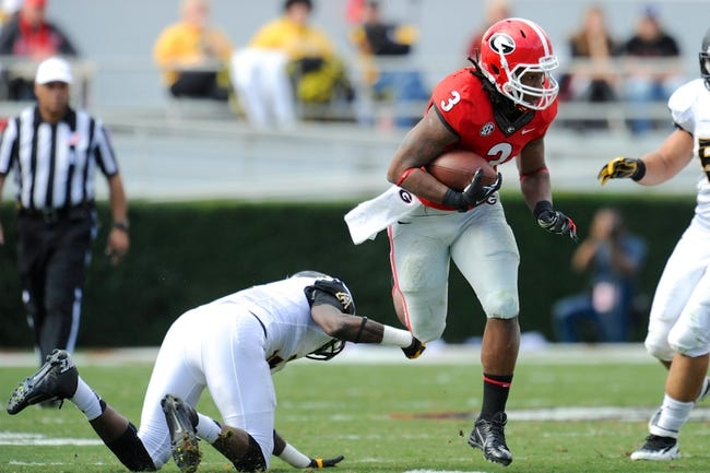 Nov 9, 2013; Athens, GA, USA; Georgia Bulldogs running back Todd Gurley (3) tries to avoid an Appalachian State Mountaineers tackler during the second quarter at Sanford Stadium. Mandatory Credit: Dale Zanine-USA TODAY Sports