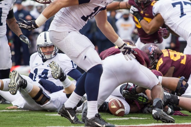 Nov 9, 2013; Minneapolis, MN, USA; Penn State Nittany Lions quarterback Christian Hackenberg (14) fumbles the ball on the one yard line in the fourth quarter against the Minnesota Gophers at TCF Bank Stadium. Minnesota wins 24-10. Mandatory Credit: Brad Rempel-USA TODAY Sports