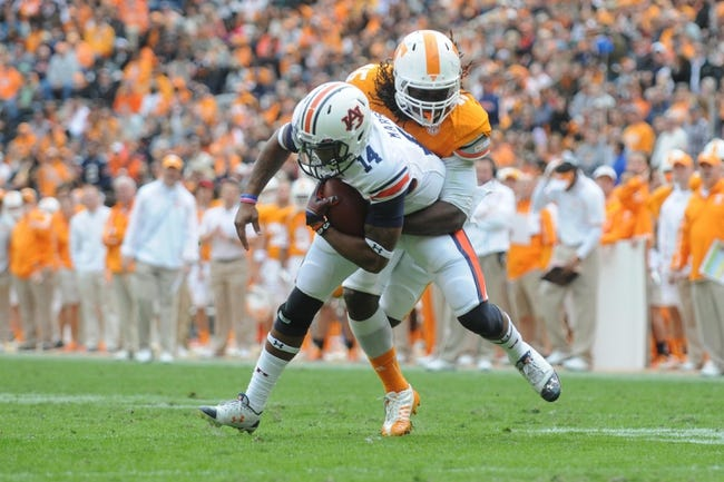 Nov 9, 2013; Knoxville, TN, USA; Tennessee Volunteers linebacker A.J. Johnson (45) tackles Auburn Tigers quarterback Nick Marshall (14) during the second half at Neyland Stadium. Auburn won 55 to 23. Mandatory Credit: Randy Sartin-USA TODAY Sports