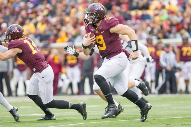 Nov 9, 2013; Minneapolis, MN, USA; Minnesota Gophers quarterback Philip Nelson (9) runs with the ball in the first quarter against the Penn State Nittany Lions at TCF Bank Stadium. Minnesota wins 24-10. Mandatory Credit: Brad Rempel-USA TODAY Sports