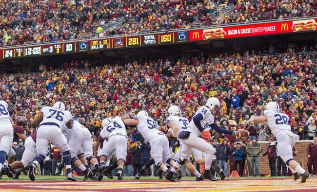 Nov 9, 2013; Minneapolis, MN, USA; Penn State Nittany Lions quarterback Christian Hackenberg (14) hands the ball off to running back Zach Zwinak (28) in the third quarter against the Minnesota Gophers at TCF Bank Stadium. Minnesota wins 24-10. Mandatory Credit: Brad Rempel-USA TODAY Sports