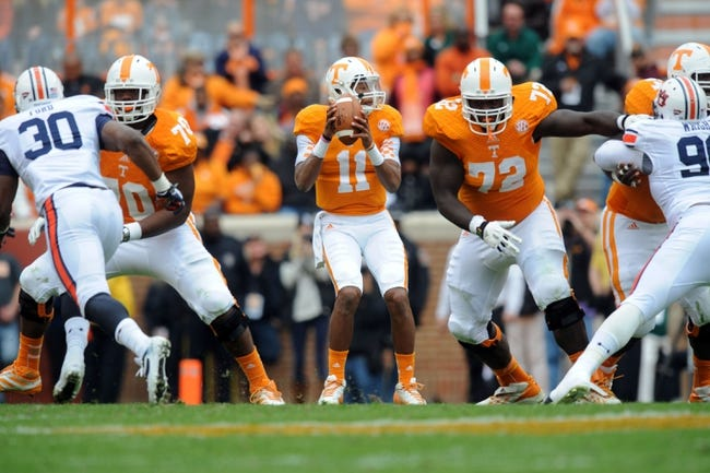 Nov 9, 2013; Knoxville, TN, USA; Tennessee Volunteers quarterback Joshua Dobbs (11) passes the ball against the Auburn Tigers during the first half at Neyland Stadium. Mandatory Credit: Randy Sartin-USA TODAY Sports