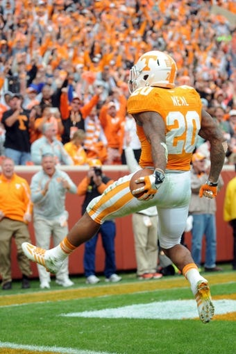 Nov 9, 2013; Knoxville, TN, USA; Tennessee Volunteers running back Rajion Neal (20) runs for a touchdown against the Auburn Tigers at Neyland Stadium. Mandatory Credit: Randy Sartin-USA TODAY Sports