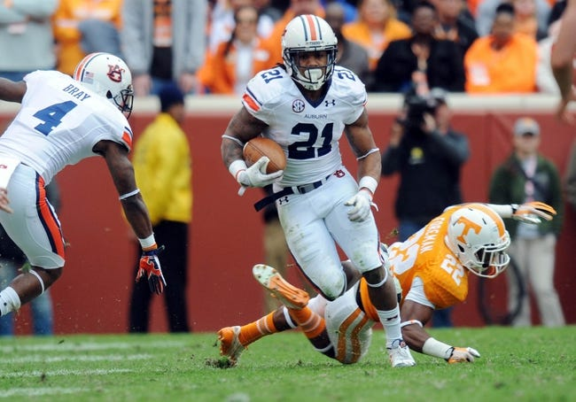Nov 9, 2013; Knoxville, TN, USA; Auburn Tigers running back Tre Mason (21) returns a kick against the Tennessee Volunteers during the first half at Neyland Stadium. Mandatory Credit: Randy Sartin-USA TODAY Sports