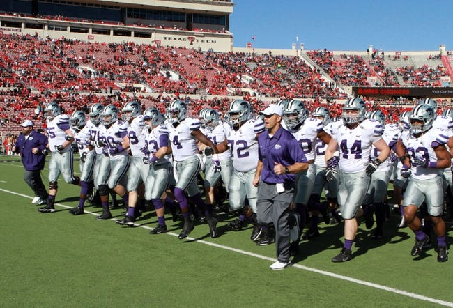 Nov 9, 2013; Lubbock, TX, USA; The Kansas State Wildcats enter the field against the Texas Tech Red Raiders at Jones AT&T Stadium. Mandatory Credit: Michael C. Johnson-USA TODAY Sports