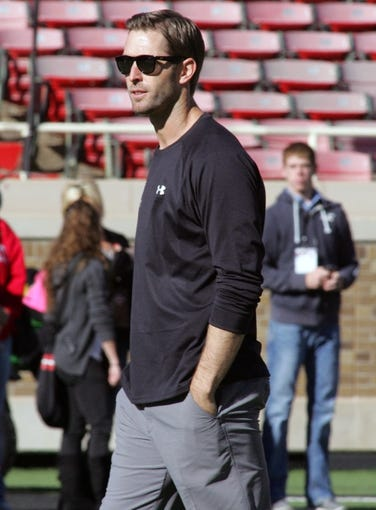 Nov 9, 2013; Lubbock, TX, USA; Texas Tech Red Raiders head coach Kliff Kingsbury on the field before the game with the Kansas State Wildcats at Jones AT&T Stadium. Mandatory Credit: Michael C. Johnson-USA TODAY Sports