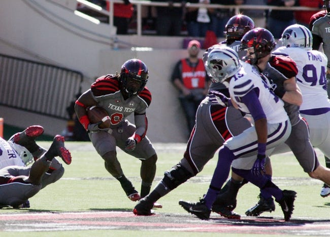 Nov 9, 2013; Lubbock, TX, USA; Texas Tech Red Raiders running back SaDale Foster (8) rushes against the Kansas State Wildcats in the first half at Jones AT&T Stadium. Mandatory Credit: Michael C. Johnson-USA TODAY Sports