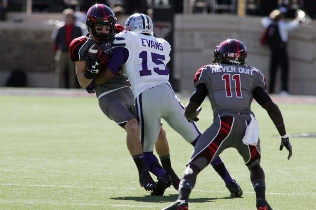 Nov 9, 2013; Lubbock, TX, USA; Kansas State Wildcats corner back Randall Evans (15) tackles Texas Tech Red Raiders wide receiver Jordan Davis (85) in the first half at Jones AT&T Stadium. Mandatory Credit: Michael C. Johnson-USA TODAY Sports