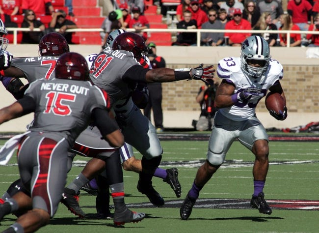 Nov 9, 2013; Lubbock, TX, USA; Kansas State Wildcats running back John Hubert (33) escapes from Texas Tech Red Raiders defensive end Kerry Hyder (91) in the first half at Jones AT&T Stadium. Mandatory Credit: Michael C. Johnson-USA TODAY Sports