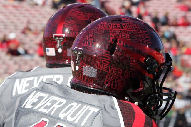 Nov 9, 2013; Lubbock, TX, USA; A detailed view of the Texas Tech Red Raiders commemorative helmets worn against the Kansas State Wildcats at Jones AT&T Stadium. Mandatory Credit: Michael C. Johnson-USA TODAY Sports