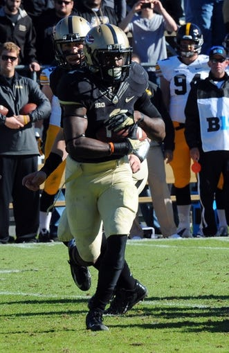 Nov 9, 2013; West Lafayette, IN, USA;  Purdue Boilermakers running back Akeem Hunt (1) runs after a hand off in the first half against the Iowa Hawkeyes at Ross Ade Stadium. Mandatory Credit: Sandra Dukes-USA TODAY Sports