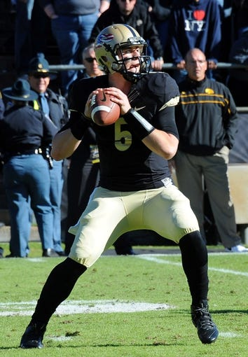 Nov 9, 2013; West Lafayette, IN, USA;  Purdue Boilermakers quarterback Danny Etling (5) looks to pass against the Iowa Hawkeyes at Ross Ade Stadium. Mandatory Credit: Sandra Dukes-USA TODAY Sports
