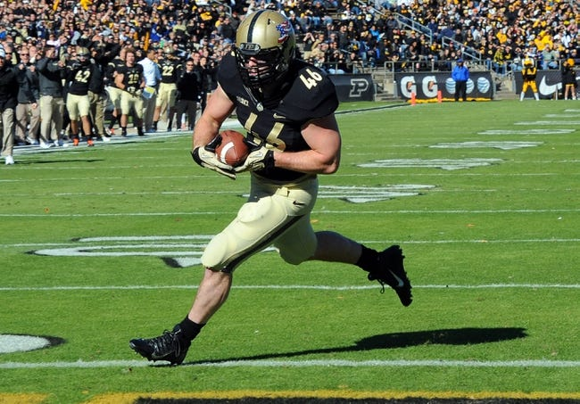 Nov 9, 2013; West Lafayette, IN, USA;  Purdue Boilermakers fullback Kurt Freytag (46) runs for a touchdown in the first half against the Iowa Hawkeyes at Ross Ade Stadium. Mandatory Credit: Sandra Dukes-USA TODAY Sports
