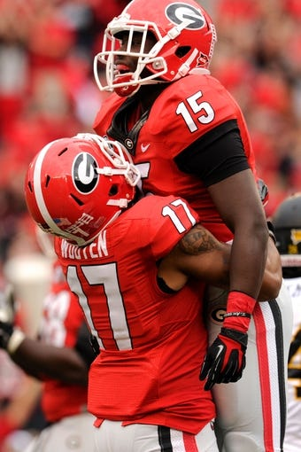 Nov 9, 2013; Athens, GA, USA; Georgia Bulldogs running back J.J. Green (15) reacts with wide receiver Rantavious Wooten (17) after scoring a touchdown against the Appalachian State Mountaineers during the second half at Sanford Stadium. Georgia defeated Appalachian State 45-6. Mandatory Credit: Dale Zanine-USA TODAY Sports