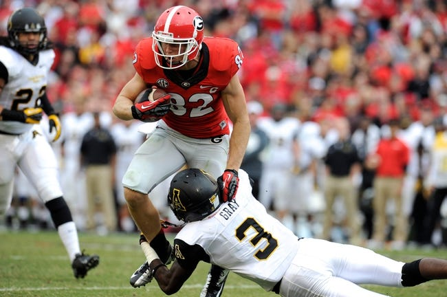 Nov 9, 2013; Athens, GA, USA; Georgia Bulldogs wide receiver Michael Bennett (82) is tackled by Appalachian State Mountaineers defensive back Alex Gray (3) during the second half at Sanford Stadium. Georgia defeated Appalachian State 45-6. Mandatory Credit: Dale Zanine-USA TODAY Sports