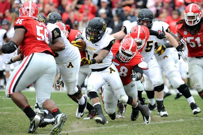 Nov 9, 2013; Athens, GA, USA; Georgia Bulldogs defensive end Sterling Bailey (58) tackles Appalachian State Mountaineers running back Marcus Cox (14) during the second half at Sanford Stadium. Georgia defeated Appalachian State 45-6. Mandatory Credit: Dale Zanine-USA TODAY Sports