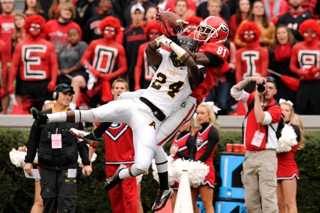 Nov 9, 2013; Athens, GA, USA; Georgia Bulldogs wide receiver Reggie Davis (81) makes a catch over top of Appalachian State Mountaineers defensive back Dante Blackmon (24) during the second half at Sanford Stadium. Georgia defeated Appalachian State 45-6. Mandatory Credit: Dale Zanine-USA TODAY Sports