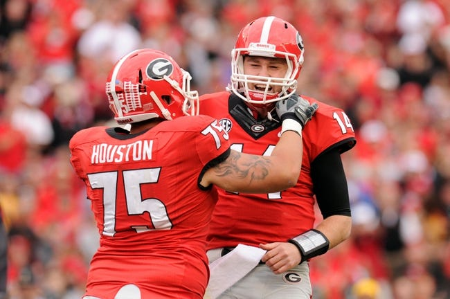 Nov 9, 2013; Athens, GA, USA; Georgia Bulldogs quarterback Hutson Mason (14) reacts with offensive tackle Kolton Houston (75) after a touchdown against the Appalachian State Mountaineers during the second half at Sanford Stadium. Georgia defeated Appalachian State 45-6. Mandatory Credit: Dale Zanine-USA TODAY Sports