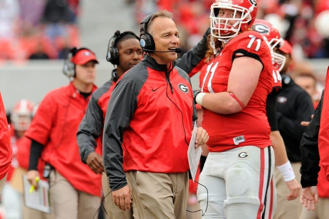 Nov 9, 2013; Athens, GA, USA; Georgia Bulldogs head coach Mark Richt reacts after a touchdown against the Appalachian State Mountaineers during the second half at Sanford Stadium. Georgia defeated Appalachian State 45-6. Mandatory Credit: Dale Zanine-USA TODAY Sports
