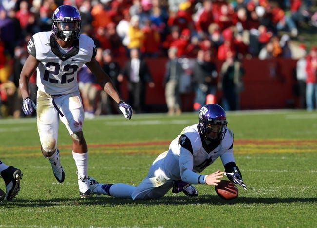 Nov 9, 2013; Ames, IA, USA; Texas Christian Horned Frogs quarterback Casey Pachall (4) recovers a fumble against the Iowa State Cyclones at Jack Trice Stadium.  Texas Christian beat Iowa State 21-17.  Mandatory Credit: Reese Strickland-USA TODAY Sports