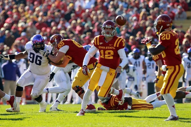 Nov 9, 2013; Ames, IA, USA;  Iowa State Cyclones quarterback Sam Richardson (12) options to running back  DeVondrick Nealy (20) against the Texas Christian Horned Frogs at Jack Trice Stadium.  Texas Christian beat Iowa State 21-17.  Mandatory Credit: Reese Strickland-USA TODAY Sports