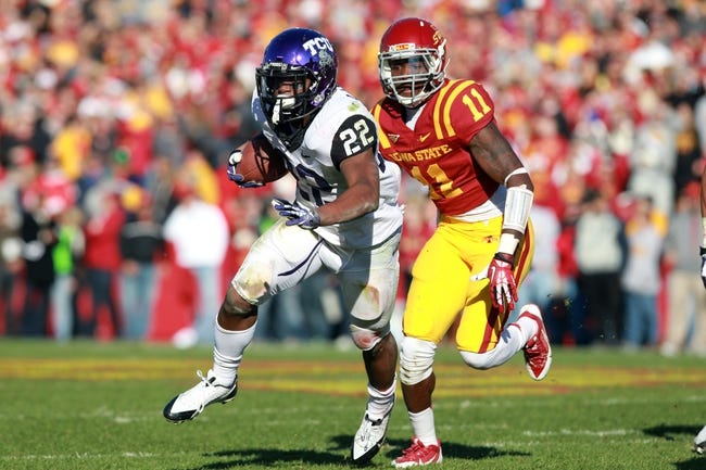 Nov 9, 2013; Ames, IA, USA; Texas Christian Horned Frogs running back Aaron Green (22) is chased by Iowa State Cyclones linebacker Charlie Rogers (11) at Jack Trice Stadium.  Texas Christian beat Iowa State 21-17.  Mandatory Credit: Reese Strickland-USA TODAY Sports
