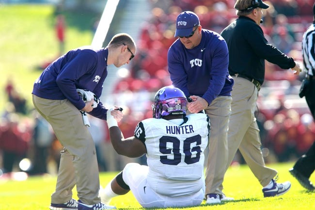 Nov 9, 2013; Ames, IA, USA; Texas Christian Horned Frogs medical staff helps defensive tackle Chucky Hunter (96) off the turf in their game agains the Iowa State Cyclones at Jack Trice Stadium. Mandatory Credit: Reese Strickland-USA TODAY Sports