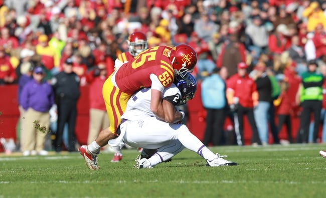 Nov 9, 2013; Ames, IA, USA; Texas Christian Horned Frogs running back Aaron Green (22) is tackled by Iowa State Cyclones linebacker Jevohn Miller (55) at Jack Trice Stadium. Mandatory Credit: Reese Strickland-USA TODAY Sports
