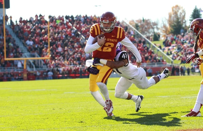 Nov 9, 2013; Ames, IA, USA; Texas Christian Horned Frogs linebacker Jonathan Anderson (41) tackles Iowa State Cyclones quarterback Sam Richardson (12) as he runs in for the Cyclone touchdown at Jack Trice Stadium. Mandatory Credit: Reese Strickland-USA TODAY Sports