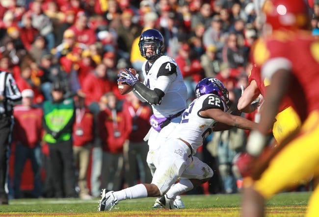 Nov 9, 2013; Ames, IA, USA; Texas Christian Horned Frogs quarterback Casey Pachall (4) looks down field agains the Iowa State Cyclones at Jack Trice Stadium. Mandatory Credit: Reese Strickland-USA TODAY Sports