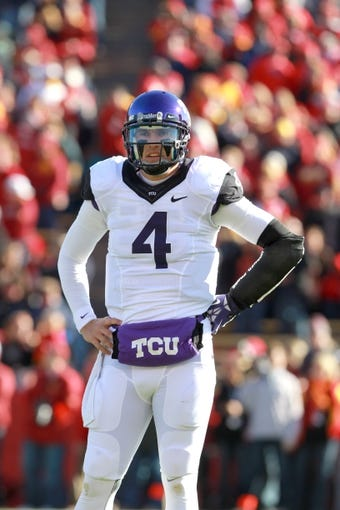 Nov 9, 2013; Ames, IA, USA; Texas Christian Horned Frogs quarterback Casey Pachall (4) looks to the sidelines during their game against the Iowa State Cyclones at Jack Trice Stadium. Mandatory Credit: Reese Strickland-USA TODAY Sports
