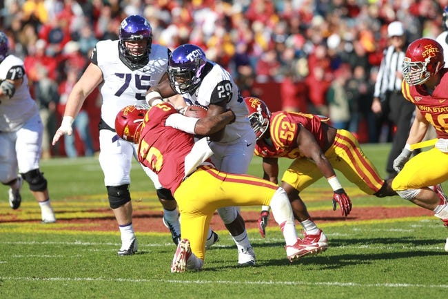 Nov 9, 2013; Ames, IA, USA; Texas Christian Horned Frogs running back Jordan Moore (29) is tackled by Iowa State Cyclones safety Jacques Washington at Jack Trice Stadium. Mandatory Credit: Reese Strickland-USA TODAY Sports