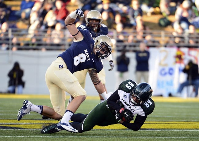 Nov 9, 2013; Annapolis, MD, USA; Navy Midshipmen safety Wave Ryder (8) attempts to strip the ball from Hawaii Warriors wide receiver Keith Kirkwood (89) during the first quarter of the Hawaii Warriors vs Navy Midshipmen game at Navy Marine Corps Memorial Stadium. Mandatory Credit: Tommy Gilligan-USA TODAY Sports