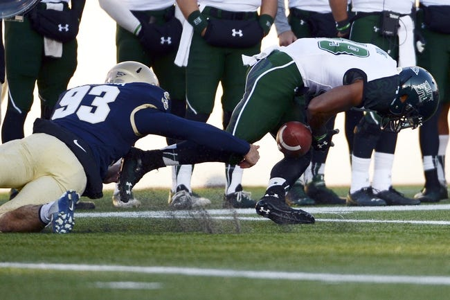 Nov 9, 2013; Annapolis, MD, USA; Navy Midshipmen long snapper Joe Cardona (93) strips the ball from Hawaii Warriors wide receiver Donnie King Jr. (49) during the first quarter of the Hawaii Warriors vs Navy Midshipmen game at Navy Marine Corps Memorial Stadium. Mandatory Credit: Tommy Gilligan-USA TODAY Sports