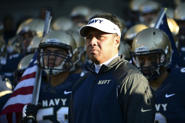 Nov 9, 2013; Annapolis, MD, USA; Navy Midshipmen head coach Ken Niumatalolo stand with his team prior to the start of the Hawaii Warriors vs Navy Midshipmen game at Navy Marine Corps Memorial Stadium. Mandatory Credit: Tommy Gilligan-USA TODAY Sports