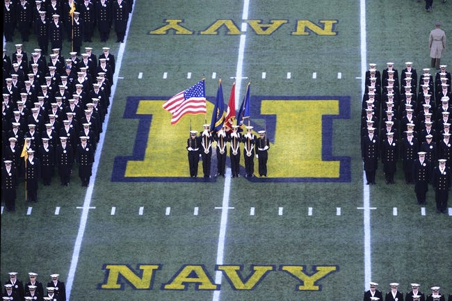Nov 9, 2013; Annapolis, MD, USA; The Navy Midshipmen color guard presents the colors during the Brigade of Midshipmen's march on prior to the start of the Hawaii Warriors vs Navy Midshipmen game at Navy Marine Corps Memorial Stadium. Mandatory Credit: Tommy Gilligan-USA TODAY Sports
