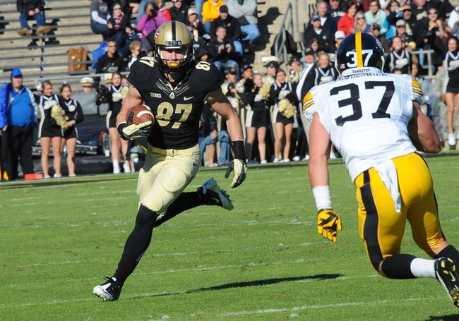 Nov 9, 2013; West Lafayette, IN, USA; Purdue Boilermakers wide receiver Shane Mikesky (87) runs with a pass as Iowa Hawkeyes defensive back John Lowdermilk (37) closes in in the second half at Ross Ade Stadium. Mandatory Credit: Sandra Dukes-USA TODAY Sports