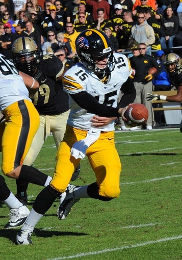Nov 9, 2013; West Lafayette, IN, USA; Iowa Hawkeyes quarterback Jake Rudock (15) prepares to hand off in the second half  at Ross Ade Stadium. Mandatory Credit: Sandra Dukes-USA TODAY Sports