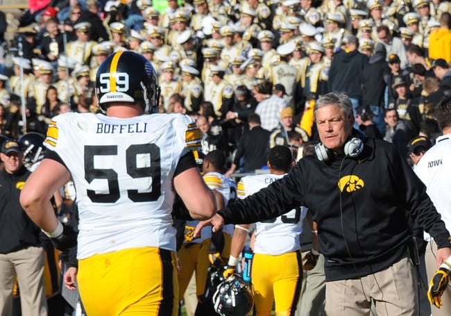 Nov 9, 2013; West Lafayette, IN, USA; Iowa Hawkeyes head coach Kirk Ferentz  congratulates Iowa Hawkeyes offensive linesman Conor Boffeli (59) after a touchdown in the second half  at Ross Ade Stadium. Mandatory Credit: Sandra Dukes-USA TODAY Sports