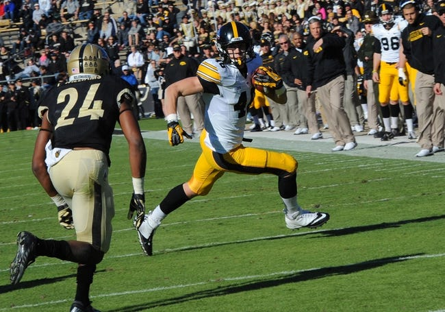 Nov 9, 2013; West Lafayette, IN, USA; Iowa Hawkeyes tight end Ike Boettger (48) runs with a pass catch as Purdue Boilermakers defensive back Frankie Williams (24) defends in the second half  at Ross Ade Stadium. Mandatory Credit: Sandra Dukes-USA TODAY Sports