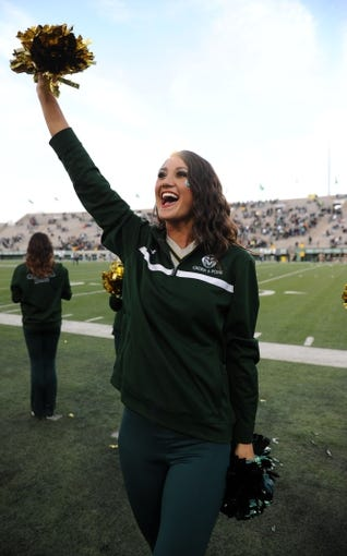 Nov 9, 2013; Fort Collins, CO, USA; Colorado State cheerleader performs in the fourth quarter against the Nevada Wolf Pack at Hughes Stadium. The Rams defeated the Wolf Pack 38-17. Mandatory Credit: Ron Chenoy-USA TODAY Sports