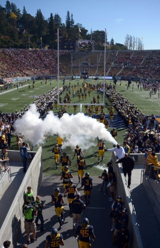 Nov 9, 2013; Berkeley, CA, USA; General view of California Golden Bears players entering Memorial Stadium through plumes of smoke before the game against the Southern California Trojans. Mandatory Credit: Kirby Lee-USA TODAY Sports
