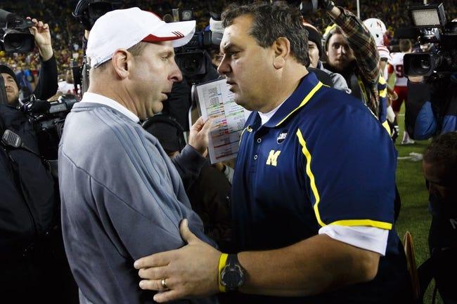 Nov 9, 2013; Ann Arbor, MI, USA; Nebraska Cornhuskers head coach Bo Pelini and Michigan Wolverines head coach Brady Hoke shake hands after the game at Michigan Stadium. Nebraska won 17-13. Mandatory Credit: Rick Osentoski-USA TODAY Sports