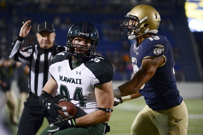 Nov 9, 2013; Annapolis, MD, USA; Hawaii Warriors running back Aofaga Wily (34) catches a pass for a touchdown against Navy Midshipmen linebacker Jordan Drake (13) during the fourth quarter at Navy Marine Corps Memorial Stadium. Navy defeated Hawaii 42-38 Mandatory Credit: Tommy Gilligan-USA TODAY Sports