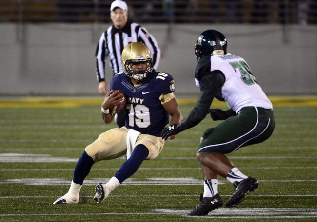 Nov 9, 2013; Annapolis, MD, USA; Navy Midshipmen quarterback Keenan Reynolds (19) runs with the ball as Hawaii Warriors defensive back Trayvon Henderson (39) attempts to tackle him during the fourth quarter at Navy Marine Corps Memorial Stadium. Navy defeated Hawaii 42-38 Mandatory Credit: Tommy Gilligan-USA TODAY Sports