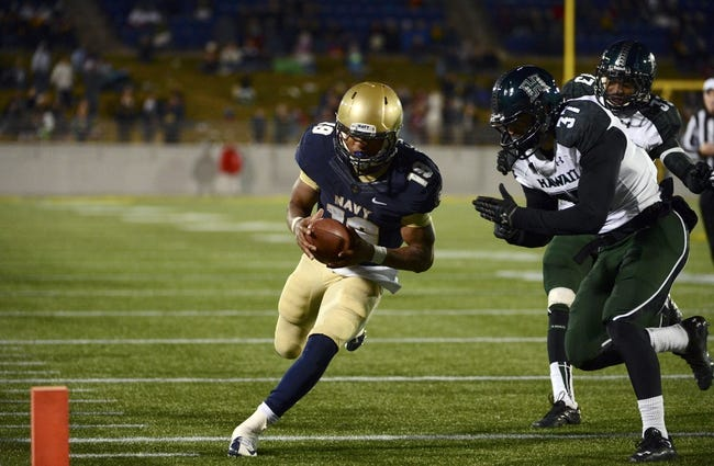 Nov 9, 2013; Annapolis, MD, USA; Navy Midshipmen quarterback Keenan Reynolds (19) beats Hawaii Warriors defensive back Charles Clay (37) to the end zone for a touchdown during the fourth quarter at Navy Marine Corps Memorial Stadium. Navy defeated Hawaii 42-38 Mandatory Credit: Tommy Gilligan-USA TODAY Sports